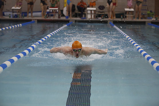 British exchange student Tom Mermagen swimming a Butterfly stroke.