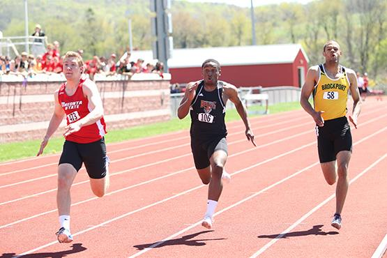 Junior sprinter Cory Cox racing in the 200m dash, where he finished highest amoung the men (21.97)